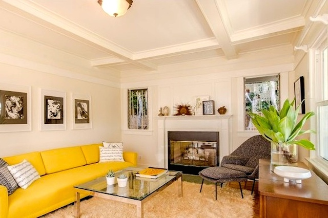 Living room with coffered ceilings and fireplace