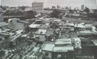 How the poor live in Manila. Squatter town in the foreground and the well to do in the background.