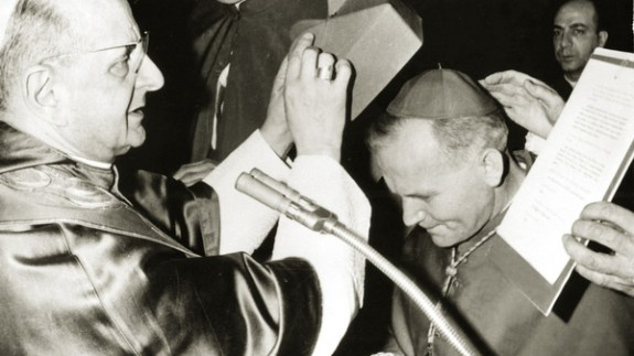 Archbishop Karol Wojtyla receives the cardinal's red biretta from Pope Paul VI in 1967