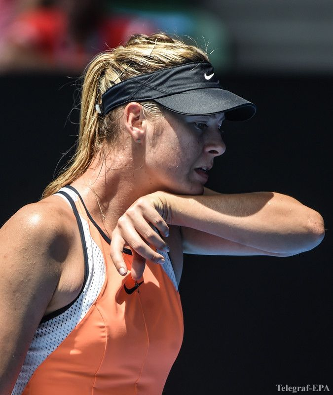 epa05126093 Maria Sharapova of Russia reacts during her quarter finals match against Serena Williams of the US at the Australian Open tennis tournament in Melbourne, Australia, 26 January 2016.  EPA/FILIP SINGER