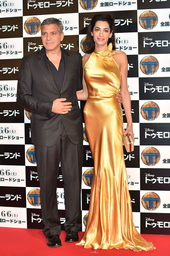"""TOKYO, JAPAN - MAY 25: Lawyer Amal Clooney (R) and actor George Clooney (L) attends the Tokyo premiere of """"Tomorrowland"""" at Roppongi Hills on May 25, 2015 in Tokyo, Japan. (Photo by Atsushi Tomura/Getty Images)"""