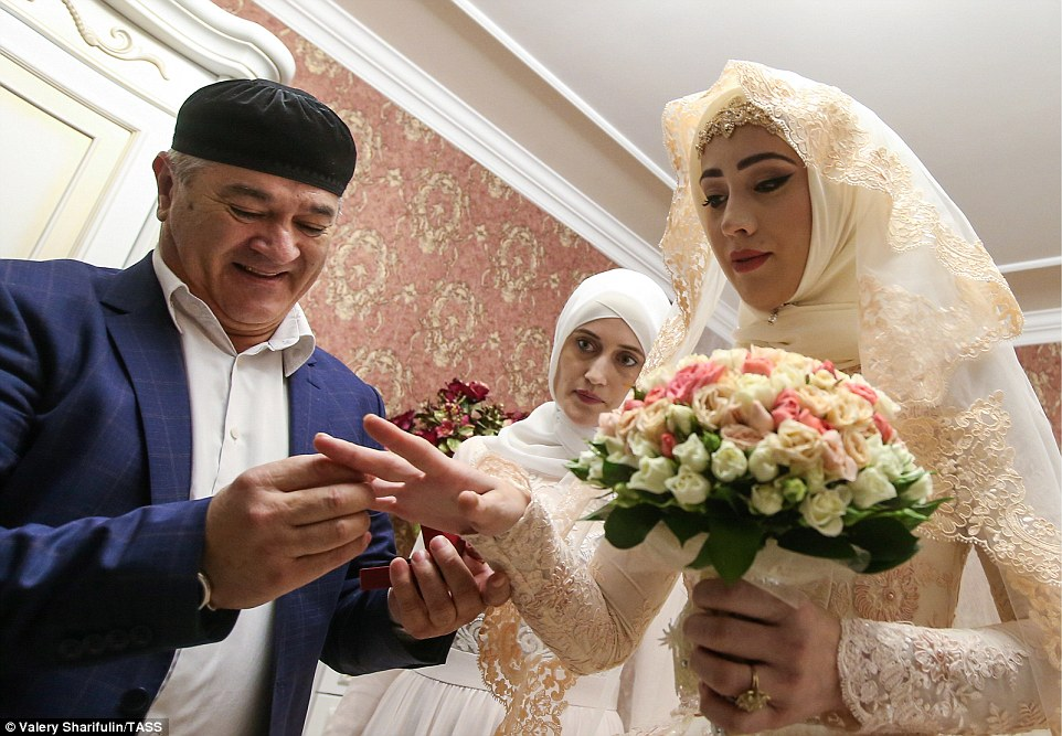 3ab7039400000578-3968480-a_man_empowered_to_act_for_the_bride_s_father_and_the_bridegroom-a-65_1480006899429