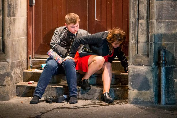 revelers-descend-on-edinburghs-city-centre-to-bring-in-the-new-year-in-edinburgh-scotland-2