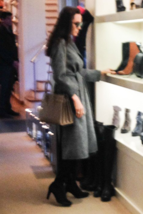AG_162775 -  - *EXCLUSIVE* West Hollywood, CA - Actress Angelina Jolie is spotted spending her Sunday with her son Pax. She keeps it chic as the pair spend some quality time while shopping at WeHo celeb favorite boutique, Fred Segal. Angelina looks happy as she browses in the shoe section. She wears a grey coat, heeled boots, and a cross body purse while out for the weekend. She seems to be back in the swing of things after a rough past year after the split from Brad Pitt. *Shot on 01/15/17* AKM-GSI 16 JANUARY 2017 To License These Photos, Please Contact :  Maria Buda  (917) 242-1505  mbuda@akmgsi.com or    Mark Satter  (317) 691-9592  msatter@akmgsi.com  sales@akmgsi.com