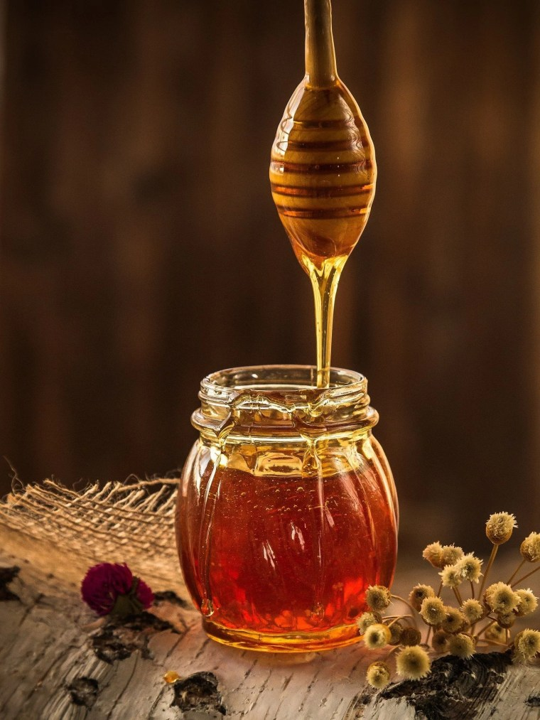 close up of honey dripping