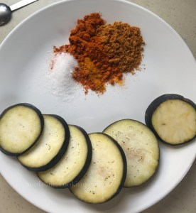 spicy eggplant fry, how to make brinjal coins. Easy brinjal recipe. Brinjal side dish recipe.