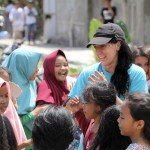 Smiling children in Lombok, Indonesia receiving aid after earthquake