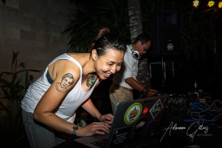 Female DJ mixing at a party