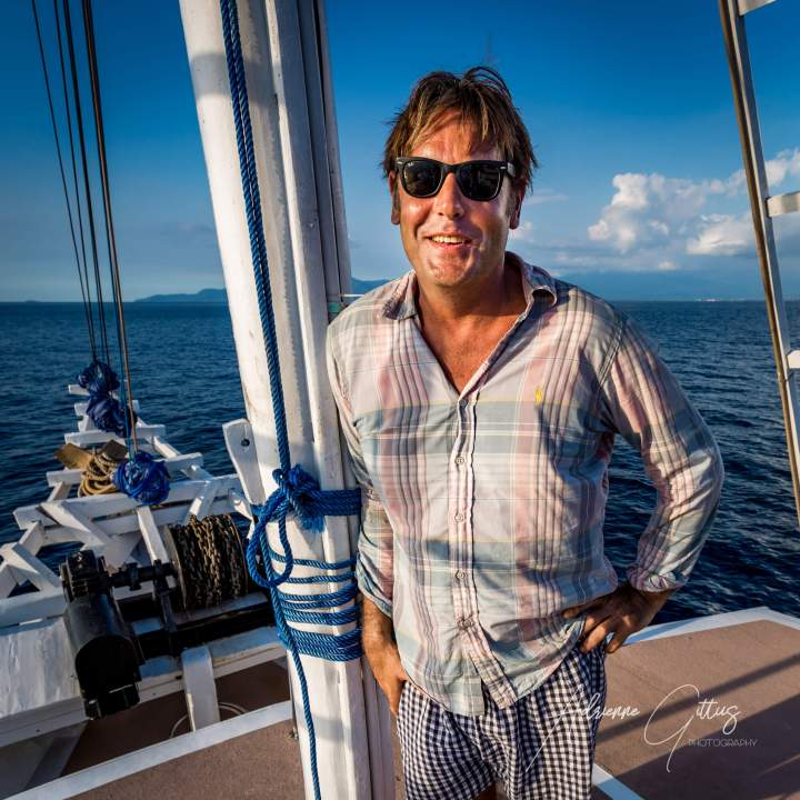 Relaxed man on deck of yacht