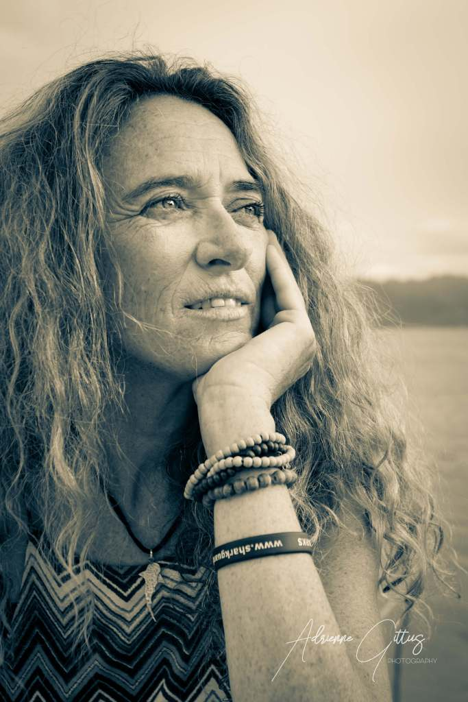 candid black and white portrait of woman, tranquil, peaceful