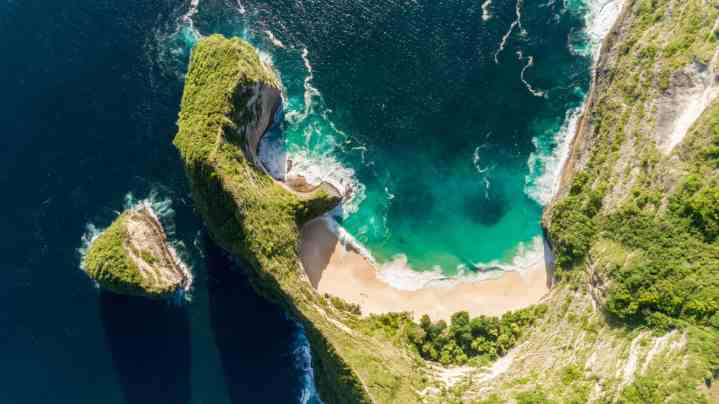 aerial drone shot looking straight down from maximum altitude at Kelingking Beach, Nusa Penida, Bali, Indonesia