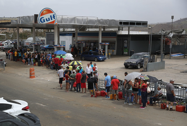 People wait in line for gas as they deal with the aftermath of Hurricane Maria on September 27. (Photo by Joe Raedle/Getty Images)