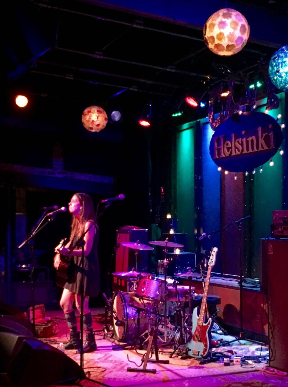 Sarah Borges singing and playing guitar at Helsinki