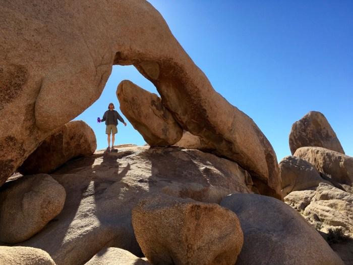 Man  under stone arch