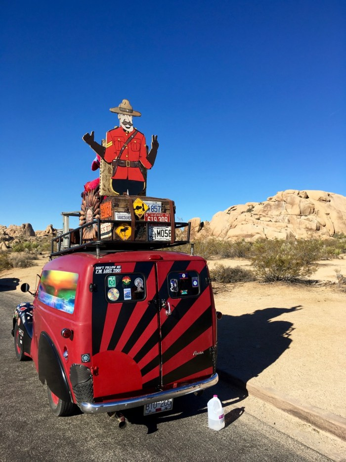 Back of colorful van with Canadian Mounty cutout on top