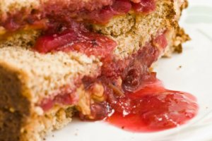 Close-up view of a cut peanut butter and jelly sandwich_
