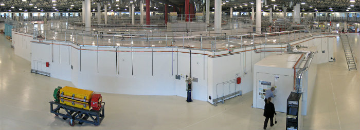 The 216 m circumference storage ring dominates this image of the interior of the Australian Synchrotron facility. In the middle of the storage ring is the booster ring and linac