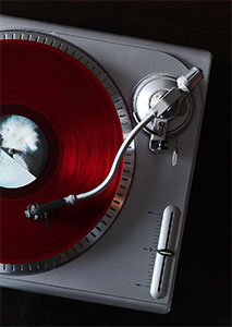 "Red vinyl 12"" on a turntable"