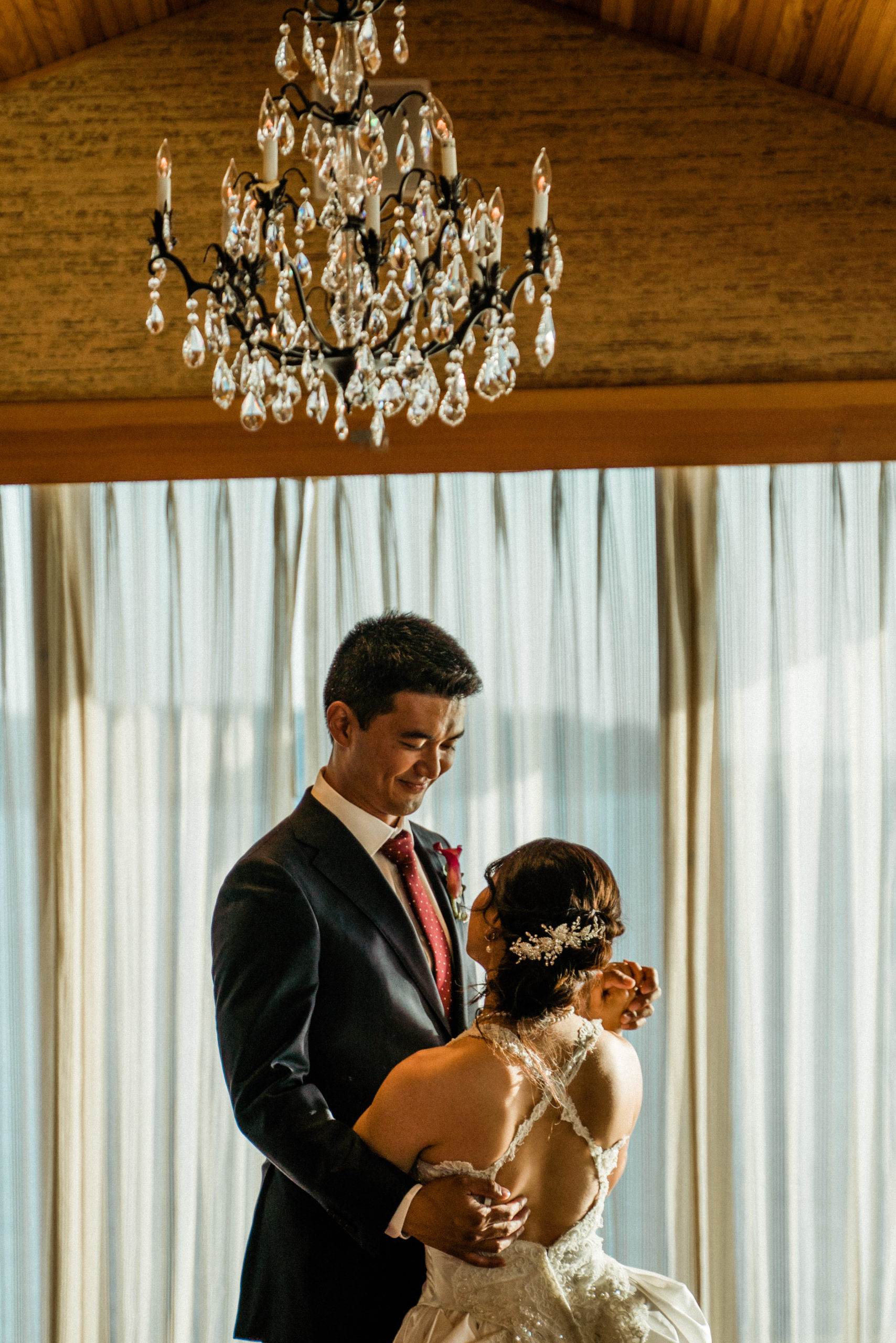 first dance in edgewater hotel wedding ballroom with floor to ceiling windows and natural light