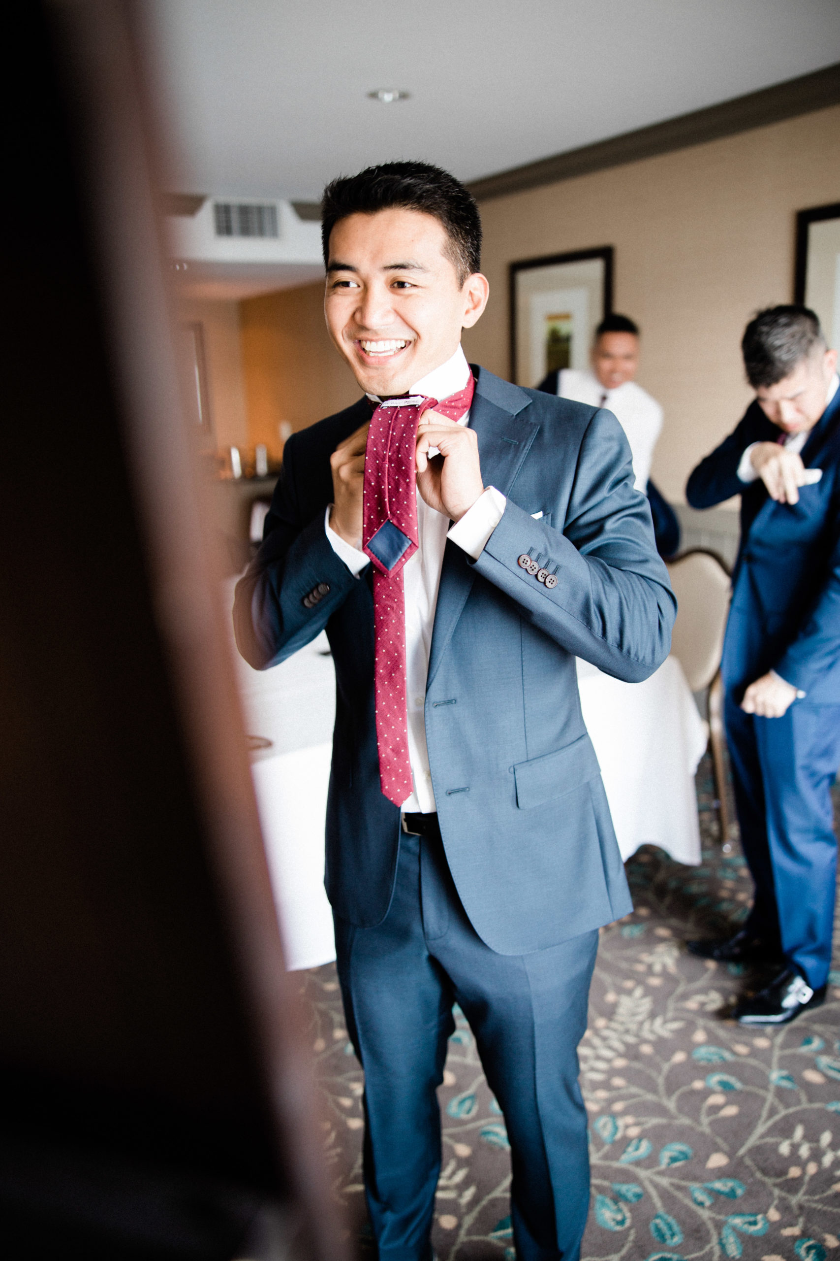 Edgewater hotel weddings have a groomsmen suite to try on tuxedos
