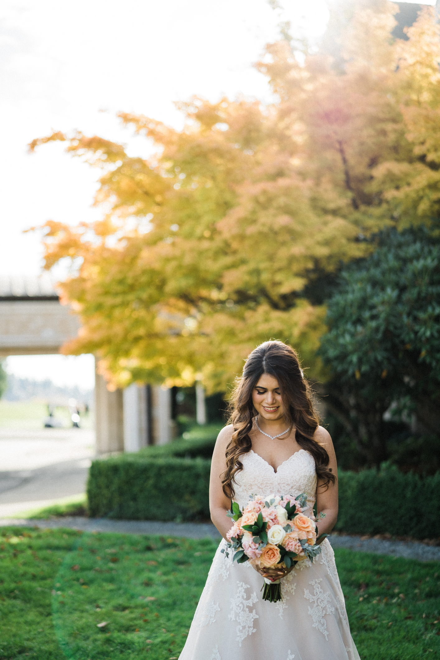 bridal portraits outside golf club at Newcastle with fall colors