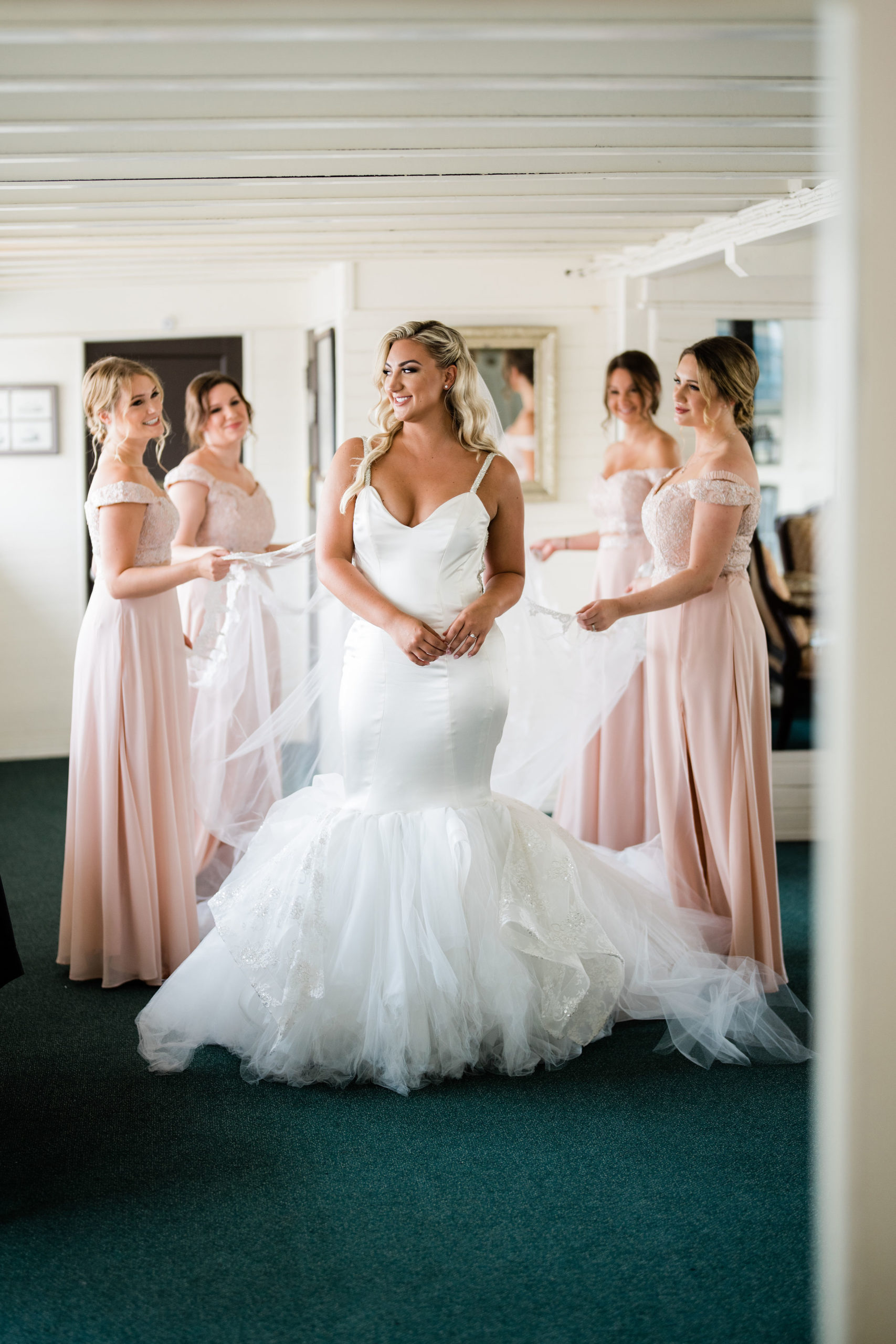 white wedding dress and brides before ceremony