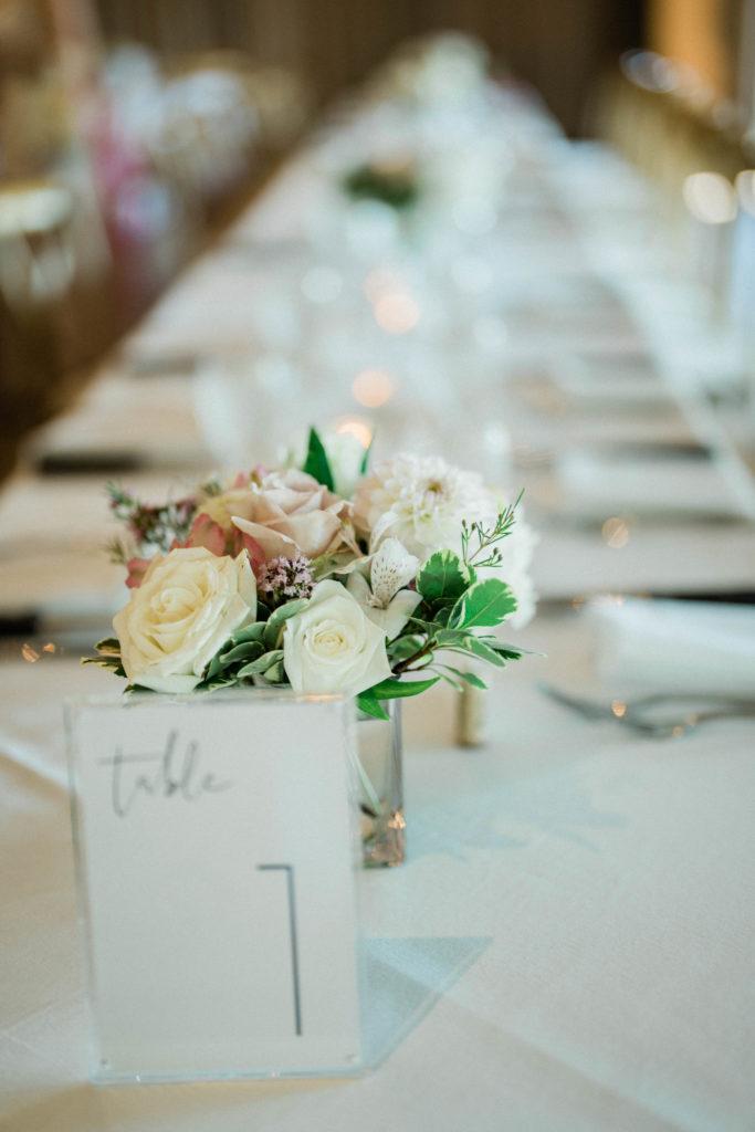 flowers decorate reception space at roche harbor wedding venue in friday harbor washington