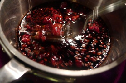 Mash the raspberries in the initial phase of reducing
