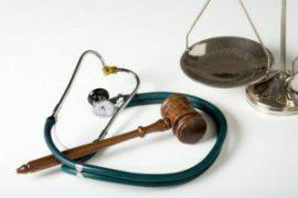 gavel, stethescope and scales of justice