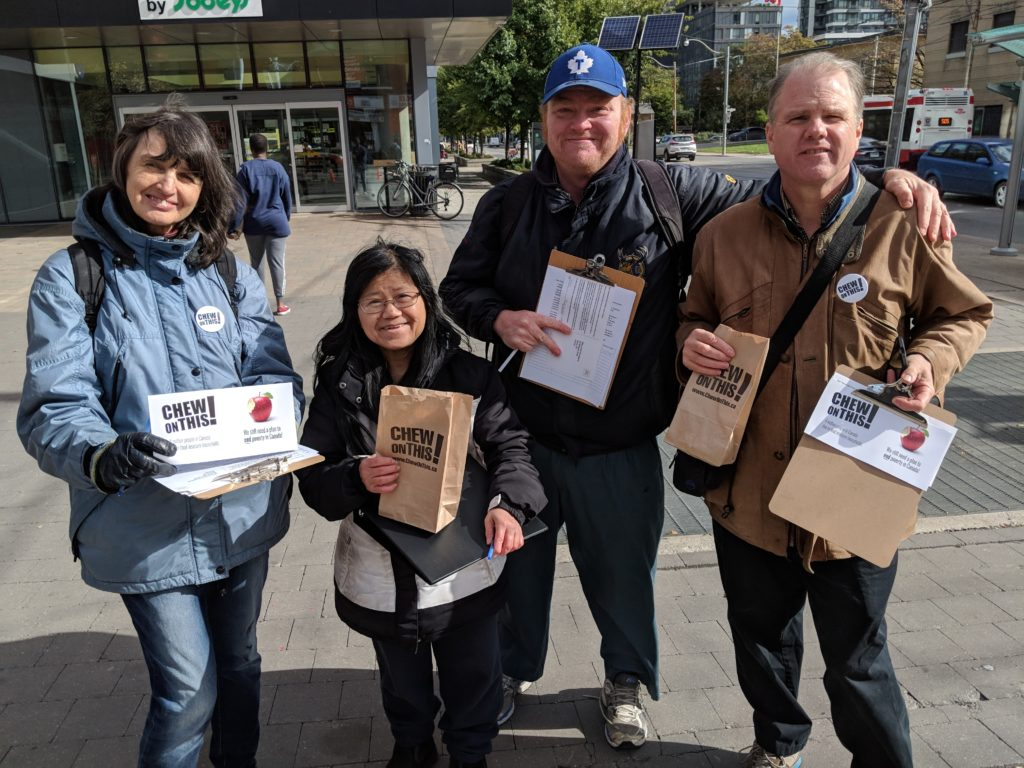 Photo of activists holding clip boards and bags promoting Chew on this campain!
