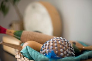 A basket of percussion instruments you might use in a music therapy session with SoundWell Music Therapy in Longmont