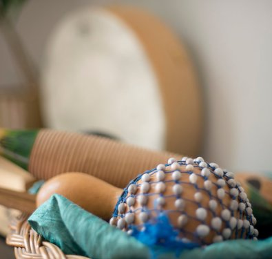 A basket of percussion instruments you might use in a music therapy session