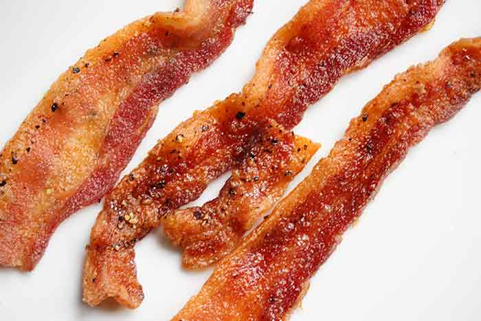 Oven baked bacon - baking bacon in the oven creates perfectly crisp bacon!