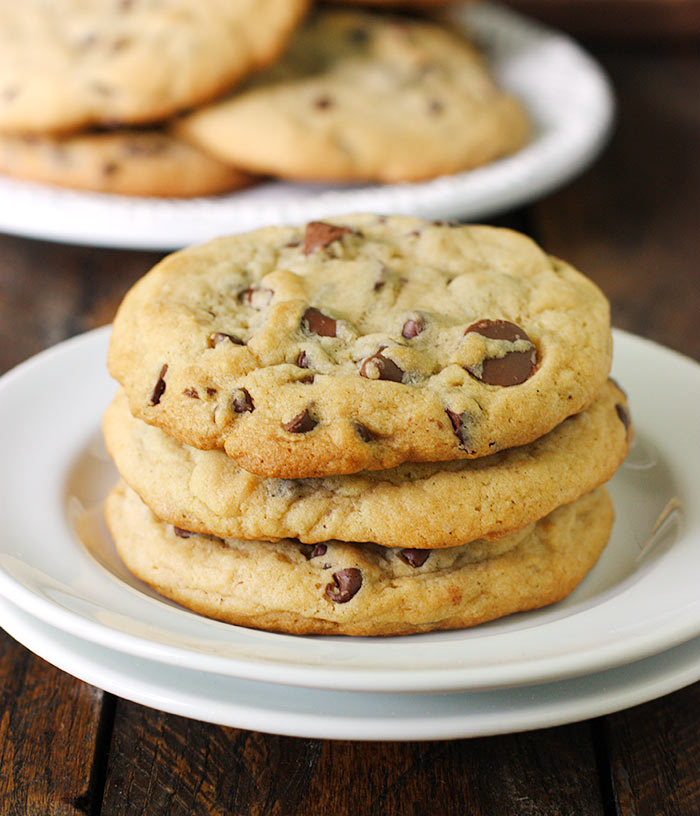 Close up of XXL soft-baked chocolate chip cookies on a plate