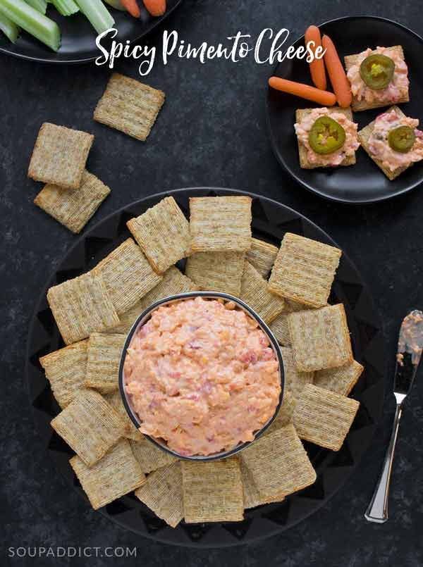 Traditional pimento cheese has nothing on this spiced up version! Smoky with just the right amount of heat, this spicy pimento cheese spread is perfect for your game day party trays. Recipe at SoupAddict.com #gameday #superbowl #snacks #dips #appetizers