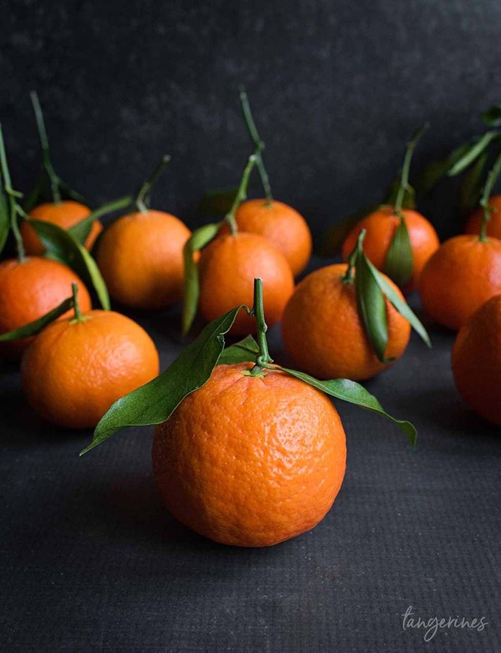 Tangerines with stems and leaves