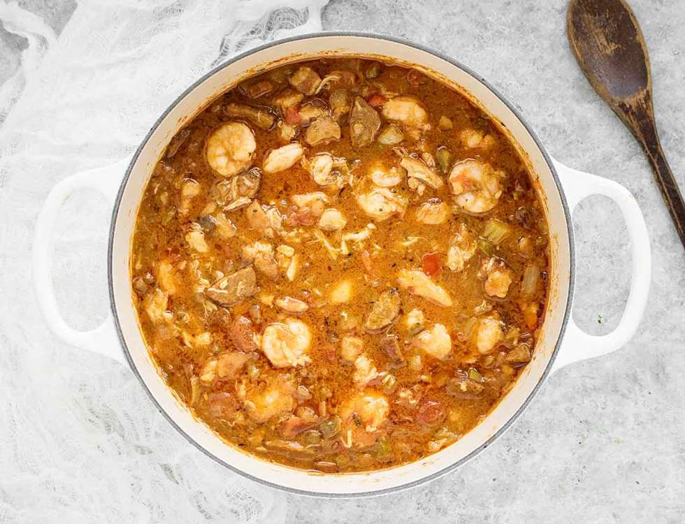 Chicken, Seafood & Sausage Gumbo in a white Dutch Oven