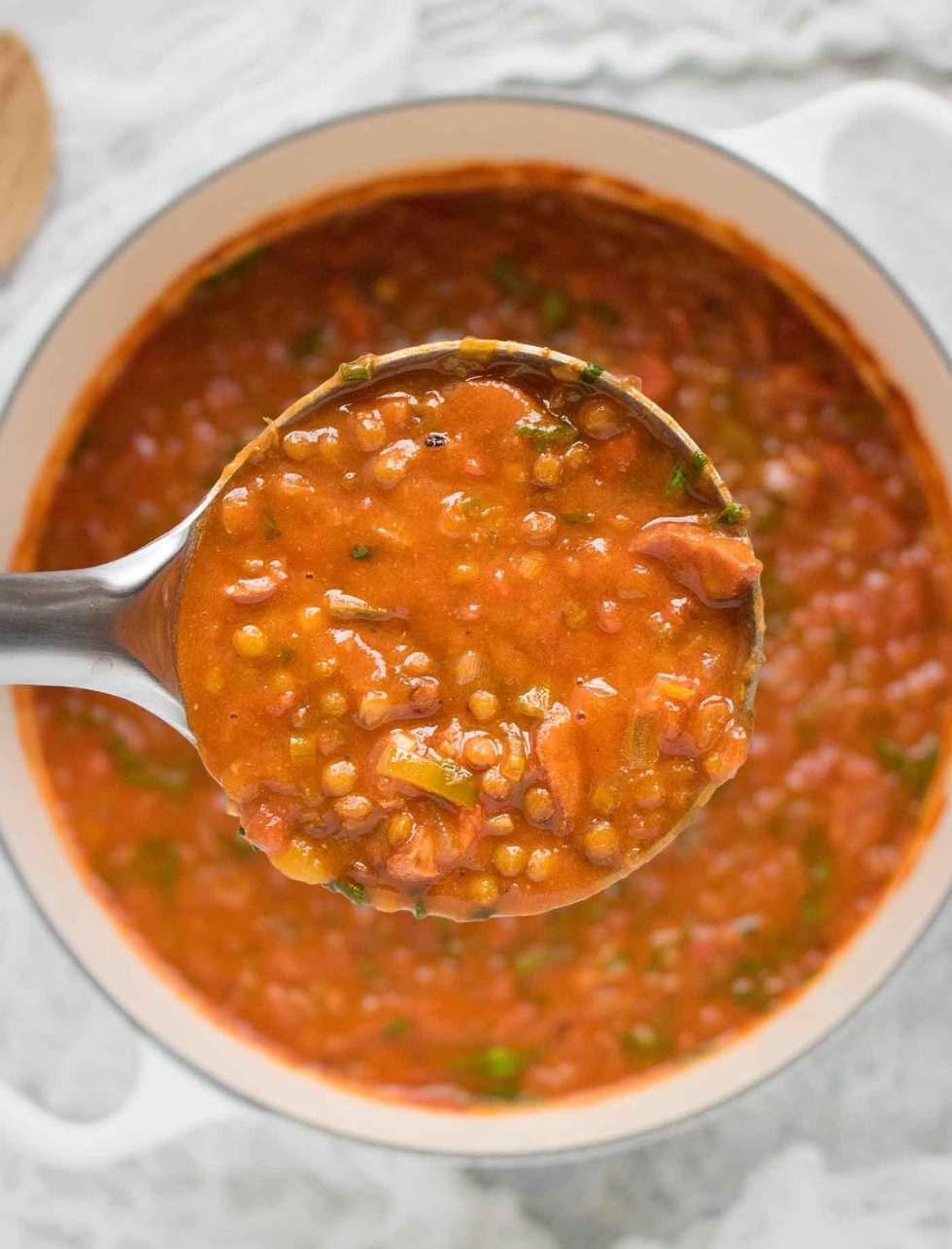 A ladle of Creole Lentil Soup