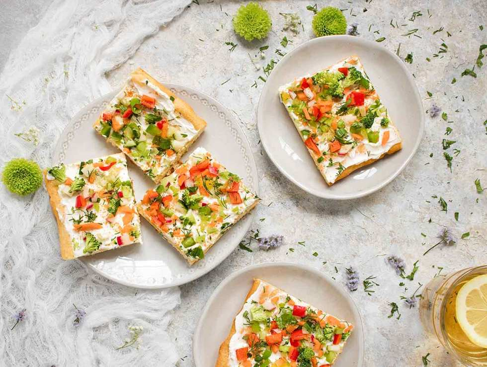 Ranch Veggie Pizza Appetizer cut into squares and served on small plates