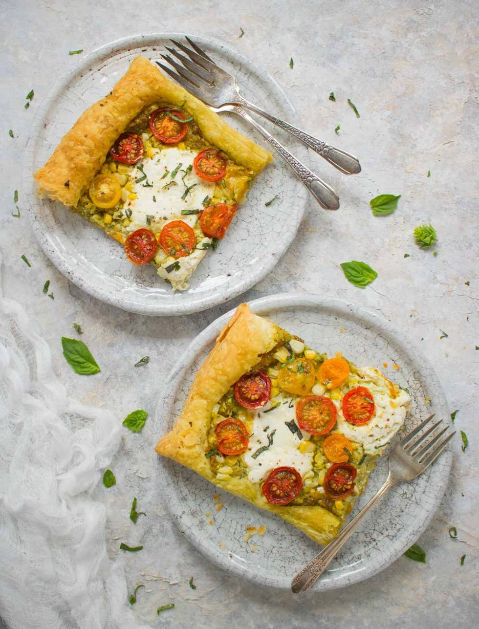 Two slices of tomato corn tart, ready to eat