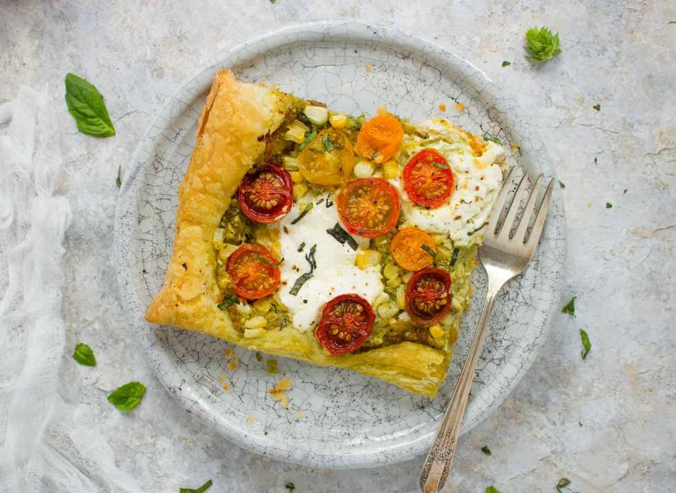 One slice of Puff Pastry Tomato Tart on a plate