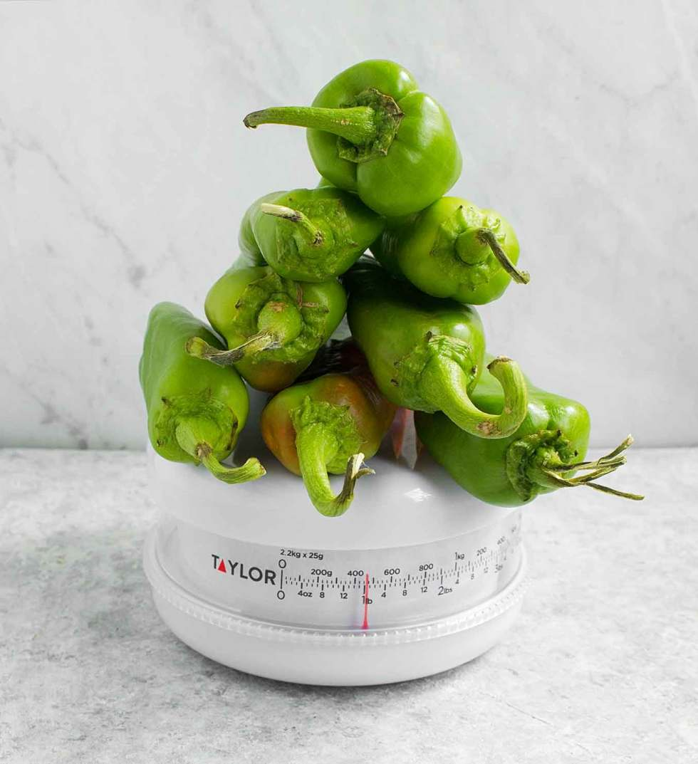 Hatch chiles on a scale, to equal a pound