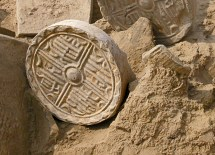 Roof tiles (above), along with fossils of mulberry leaves (signaling silk production), have emerged at the site, leading researchers to believe the area may mark the beginning of China's Silk Road trade. (Courtesy of Henan Provincial Institute of Cultural Relics and Archaeology)