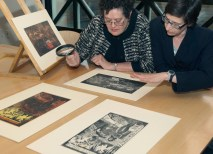Professor Childs and Elizabeth Wyckoff, PhD, curator of Prints, Drawings and Photographs at the Saint Louis Art Museum, examine the museum's excellent collection of prints by Gauguin and other late 19th-century French artists. (David Kilper)