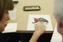 Lynn Hamilton (left) discusses art work with Rivie Soll, (Photo: Whitney Curtis/Washington University)