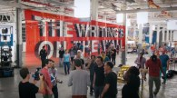 Dozens of people on set for the OK Go video The Writing's on the Wall