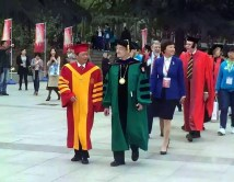 Dr. Wang Shuguo, president of Xi'an Jiaotong University and Washington University Chancellor Mark S. Wrighton lead the procession into the opening of the 120th anniversary celebration of XJTU.
