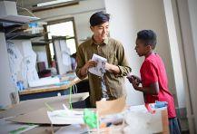 Recent alumnus Jun Bae works with students in Givens Hall. (Photo: James Byard/Washington University)