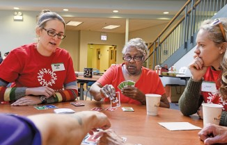 On April 9, 2016, after providing a continental breakfast, 15 alumni volunteers spent the morning getting to know the residents of St.Brendan Apartments, a senior independent housing facility affiliated with Catholic Charities of the Archdiocese of Chicago. Alumna Megan Foran (left), BSME '13, BSAS '13, was among those playing cards with Barbara Tisdale (center), a resident of St. Brendan Apts. (Matt Marton/WUSTL Photos)