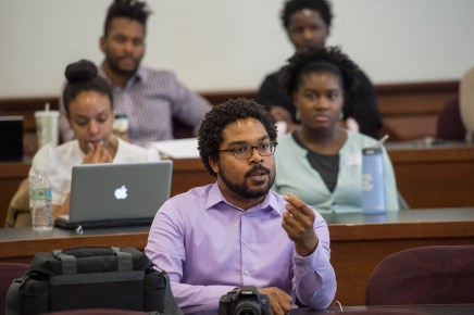 Jonathan Jackson (center), MA '10, PhD '14, an alumnus of the Chancellor's Graduate Fellowship Program, studied psychological and brain sciences while at the university. He is currently an instructor at Harvard Medical School. (Photo: Joe Angeles)